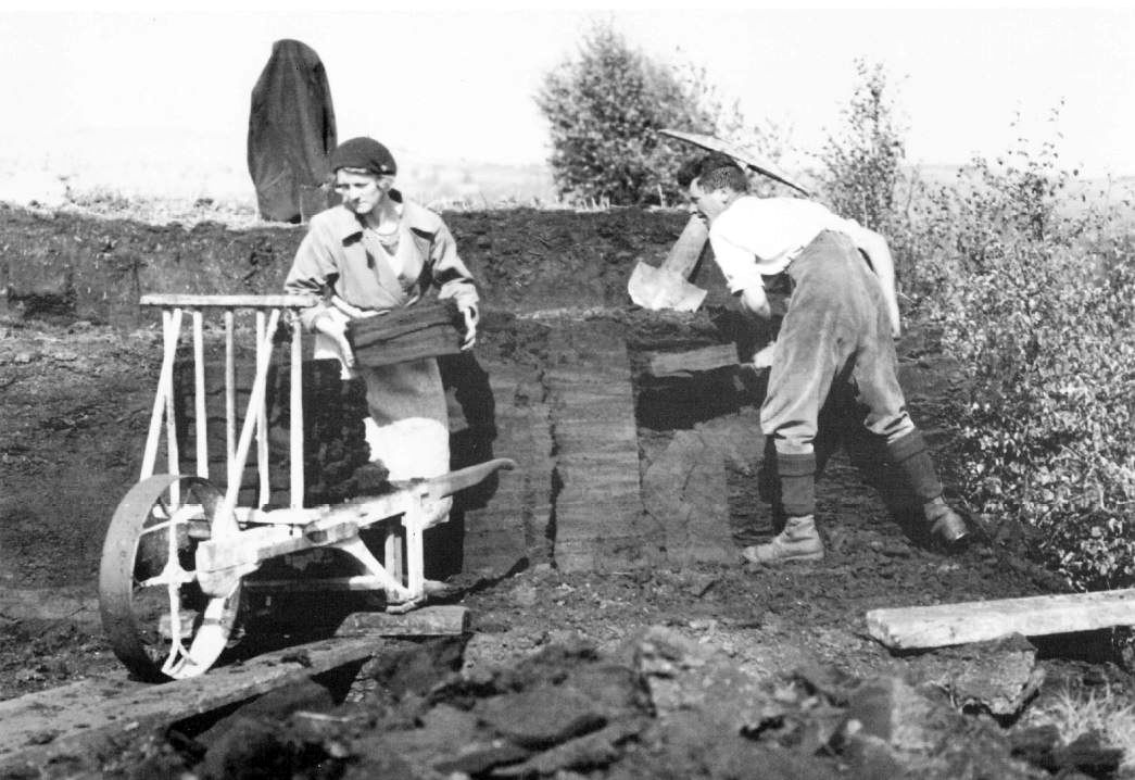 Edgar and Clara Park, at South Low Farm, cutting peat, using special tools and cart