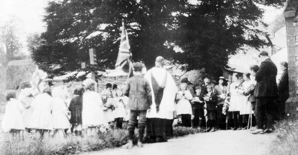 Remembrance Service - School Children at church beside the Remembrance Cross, 1920s