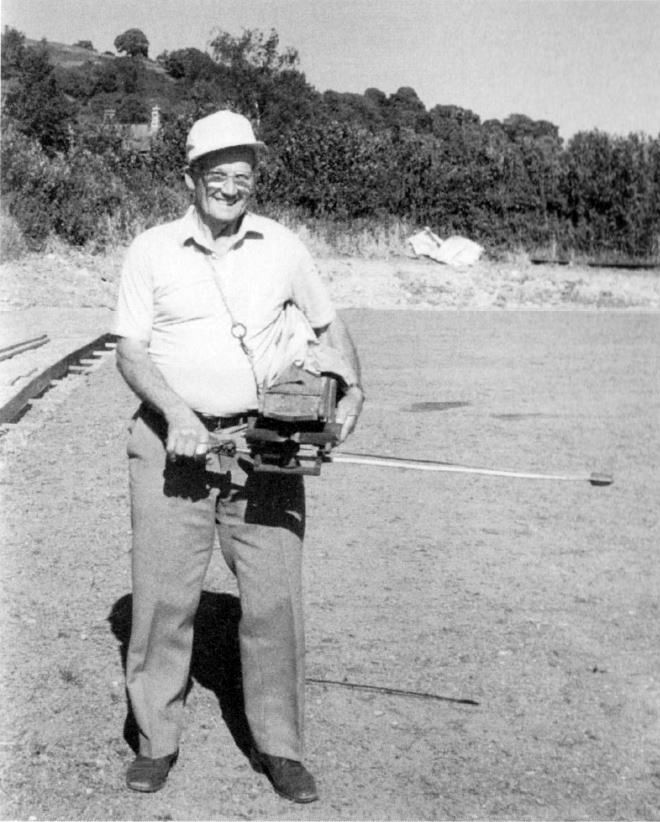 Jack Myers sowing the bowling green grass seed with a fiddle drill